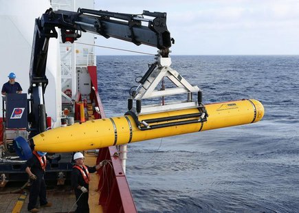 Crew aboard the Australian Defence Vessel Ocean Shield move the U.S. Navy's Bluefin-21 autonomous underwater vehicle into position for deplo