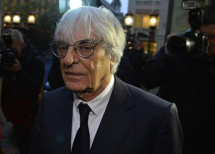 Formula One Chief Executive Bernie Ecclestone leaves the High Court in central London November 6, 2013. REUTERS/Toby Melville