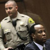 Doctor Conrad Murray (R), the late Michael Jackson's personal physician, listens during his arraignment on a charge of involuntary manslaugh