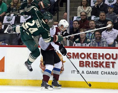 Apr 21, 2014; Saint Paul, MN, USA; Minnesota Wild forward Matt Cooke (24) hits Colorado Avalanche defenseman Nick Holden (2) during the firs