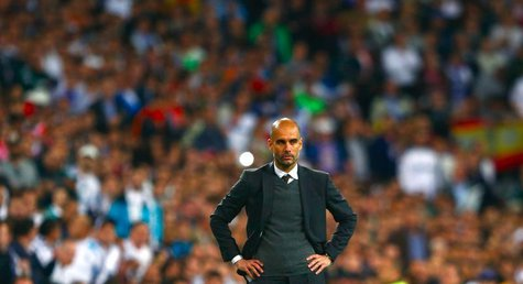 Bayern Munich's coach Josep Guardiola reacts during the Champions League semi-final first leg soccer match against Real Madrid at Santiago B