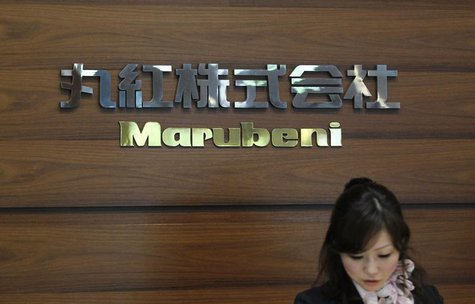 A receptionist works in front of the logo of Japanese trading house Marubeni Corp at the company's headquarters in Tokyo May 29, 2012. REUTE