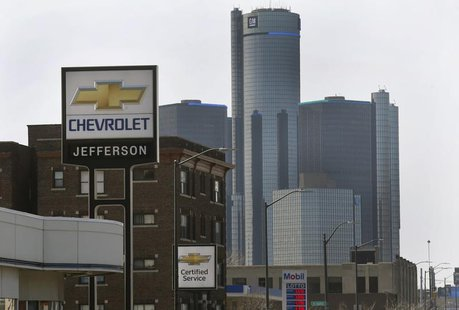 The sign to a Chevrolet automobile dealership is seen down the street from General Motors World Headquarters on Jefferson Avenue in Detroit,
