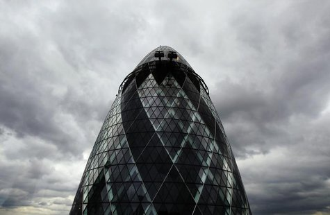 Dark clouds gather over 30 St. Mary Axe, formerly known as the Swiss RE building and also known as the Gherkin, in London August 12, 2010. R