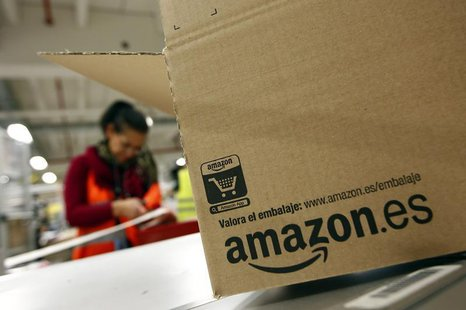 A worker packs a box at Amazon's logistics centre in Graben near Augsburg December 16, 2013. REUTERS/Michaela Rehle