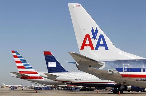 The tail sections of a newly designed American Airlines aircraft (L), a US Airways aircraft (C) and a traditional American Airlines aircraft