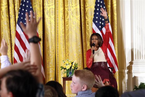 U.S. first lady Michelle Obama takes questions wile speaking with children of Executive Office employees at the White House's annual Take Ou
