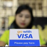 A Visa sign is seen on a cashier's desk at a restaurant in Yangon January 31, 2013. REUTERS/Soe Zeya Tun