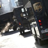 UPS delivery trucks are seen in New York City March 6, 2014. REUTERS/Mike Segar