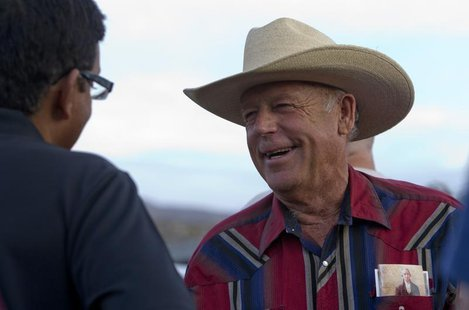 "Rancher Cliven Bundy (R) greets a supporter during a Bundy family ""Patriot Party"" near Bunkerville, Nevada, April 18, 2014. REUTERS/Steve Ma"