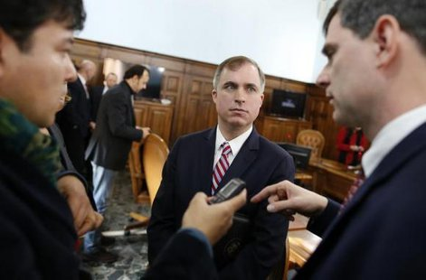 U.S. prosecutors Marshall Miller (C) and William Nardini (R) talk with a reporter at the end of a news conference in Rome February 11, 2014. CREDIT: REUTERS/TONY GENTILE