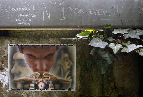 Handwritten notes left by fans are pictured on a fence at the site where Brazilian Formula One driver Ayrton Senna died at the race track in