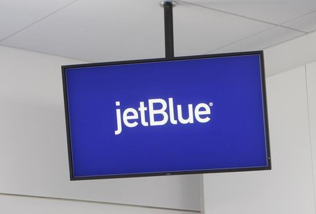 JetBlue Airways logo is displayed on a monitor in Terminal 5 at John F. Kennedy International Airport during a terminal test in New York Aug