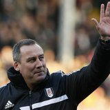 Fulham's head coach Rene Meulensteen waves before their English Premier League soccer match against Swansea City at Craven Cottage in London