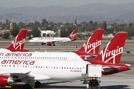 A Virgin America jet takes off past other aircraft parked at Terminal 3 at Los Angeles airport (LAX), California November 2, 2013. REUTERS/D
