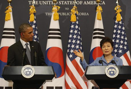 U.S. President Barack Obama listens to South Korean President Park Geun-hye at a joint news conference at the Blue House in Seoul April 25,