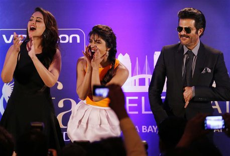 Bollywood Actress Priyanka Chopra (C) and Actress Sonakshi Sinha and Anil Kapoor (R) entertain the crowd ahead of the 15th International Ind