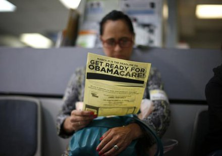 Arminda Murillo, 54, reads a leaflet at a health insurance enrollment event in Cudahy, California March 27, 2014. CREDIT: REUTERS/LUCY NICHOLSON