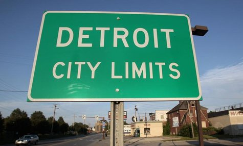 A 'Detroit City Limits' border sign is seen as traffic enters a westside neighborhood in Detroit, Michigan July 22, 2013. REUTERS/ Rebecca C