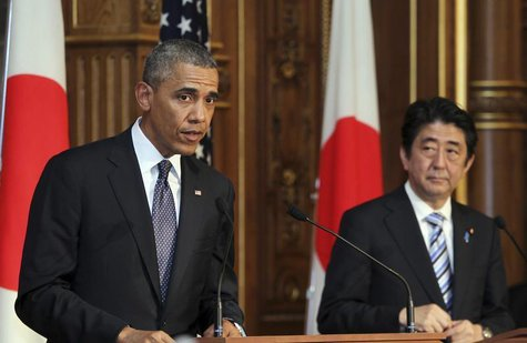 U.S. President Barack Obama (L) attends a news conference with Japanese Prime Minister Shinzo Abe (R) at the Akasaka guesthouse in Tokyo Apr