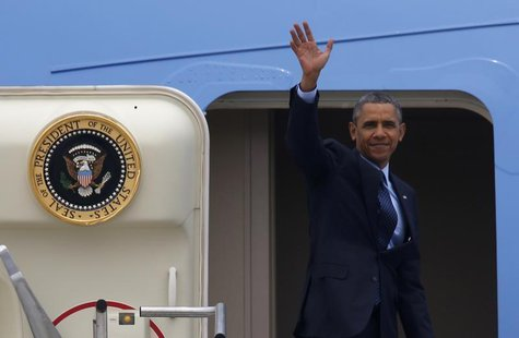 U.S. President Barack Obama waves before boarding Air Force One at Osan Air Base, as he leaves South Korea for Malaysia, in Pyeongtaek April