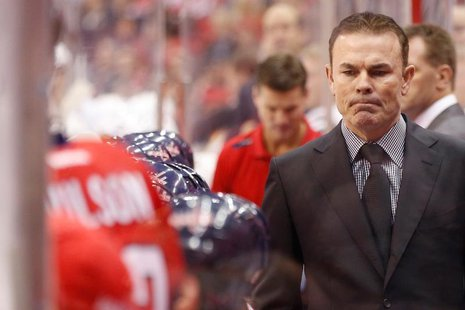 Nov 20, 2013; Washington, DC, USA; Washington Capitals head coach Adam Oates looks on from behind the bench against the Pittsburgh Penguins