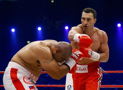 World heavyweight boxing champions Vladimir Klitschko of Ukraine lands a punch on Australian challenger Alex Leapai (L) during their WBO hea