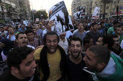 Demonstrators shout slogans against the government and Egypt's former army chief Abdel Fattah al-Sisi near El-Thadiya presidential palace in