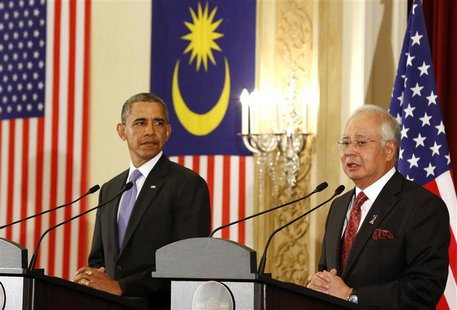 U.S. President Barack Obama and Malaysian Prime Minister Najib Razak participate in a joint news conference at the Perdana Putra Building in