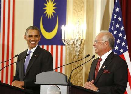 U.S. President Barack Obama and Malaysian Prime Minister Najib Razak both smile as they participate in a joint news conference at the Perdan