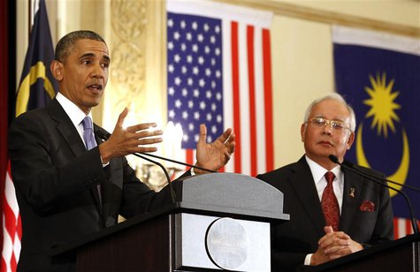 U.S. President Barack Obama speaks next to Malaysian Prime Minister Najib Razak during joint news conference at the Perdana Putra Building i