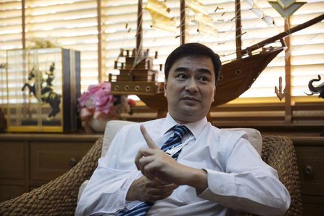 Thailand's opposition leader and former Prime Minister Abhisit Vejjajiva gestures during an interview with foreign media at his Democrat Par