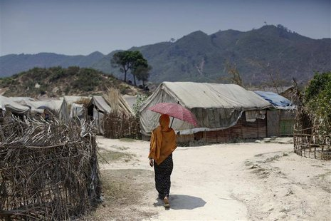 A Rohingya woman walks at the Kyein Ni Pyin camp for internally displaced people in Pauk Taw, Rakhine state, April 23, 2014. REUTERS/Minzaya