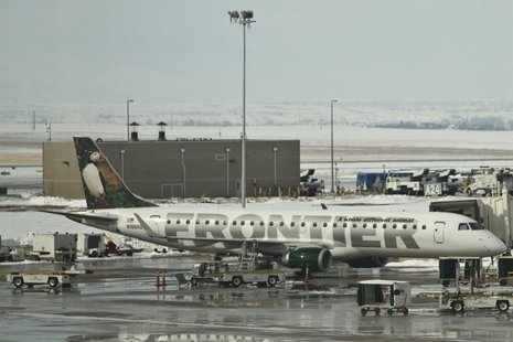 A Frontier Airlines jet waits at the gate prior to departure at the Denver International Airport in Denver, Colorado, February 4, 2012. REUT