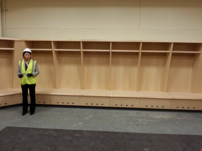 Kendra Siemonsma talks about the wood fixtures in the Sioux Falls Stampede locker room. The room is specially heated and ventilated to remove locker room odors. All of the center's locker rooms may also be used as multi-purpose rooms for other events.