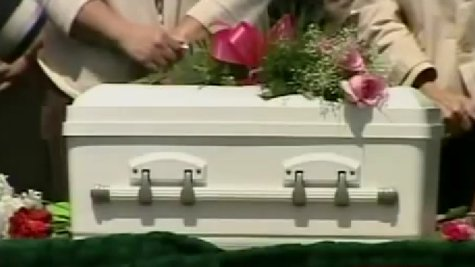 Casket of Baby Theresa, whose remains were found in Dodge County on April 29, 2009, shown during burial ceremony. (Photo from: FOX 11/YouTube).