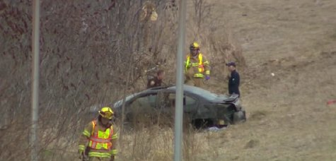 Authorities respond to a crash at the ramp of I-43 onto westbound Highway 172 in Bellevue on April 27, 2014. (Photo from: FOX 11/YouTube).
