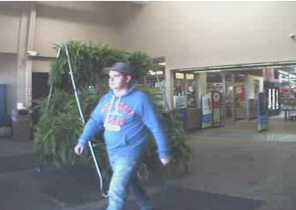 One of two break-in suspects walking out of store (courtesy Michigan State Police)