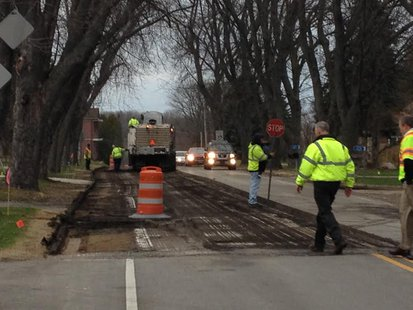Workers begin removing asphalt on LS