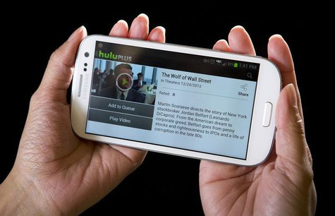 The HULU Plus app plays a movie trailer on a Samsung Galaxy phone in this photo-illustration in New York, December 23, 2013. REUTERS/Carlo A