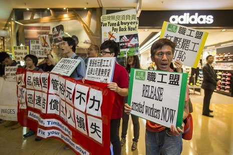 Protesters from labour organizations shout slogans in support of the strike by workers at a Yue Yuen Industrial Holdings Ltd shoe factory co