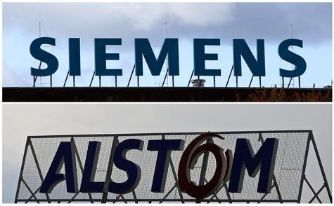 A combination of two file photographs shows the logos of Siemens AG company (top) in Berlin October 9, 2012 and of French power and transpor