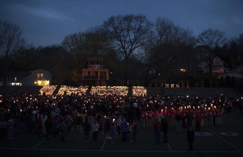 People gather at Jonathan Law High School during a vigil for slain student Maren Sanchez in Milford, Connecticut April 28, 2014. REUTERS/Mic