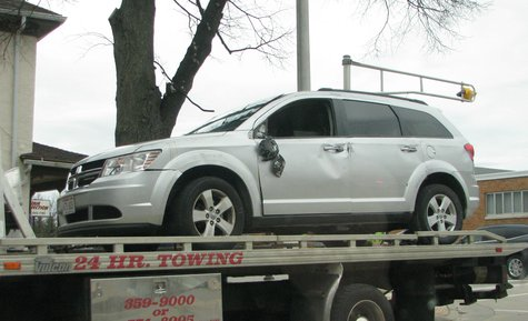 It's on its wheels now, but this Dodge Journey was on its roof after a collision at Wausau's 3rd and McIndoe Streets 4/28/14.