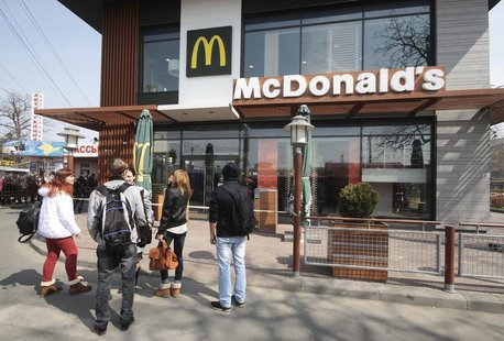 People gather outside a McDonald's restaurant, which was earlier closed for clients, in the Crimean city of Simferopol April 4, 2014. REUTER