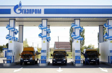 Vehicles are seen at a gas filling station, owned by Gazprom Transgaz Stavropol, with the company logo of Russian natural gas producer Gazpr