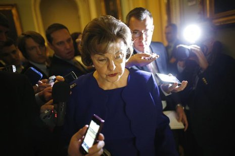 U.S. Senator Dianne Feinstein (D-CA) is trailed by reporters as she walks to the weekly Democratic caucus policy luncheon at the U.S. Capito