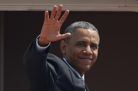 U.S. President Barack Obama waves from Air Force One as he departs Haneda International Airport in Tokyo April 25, 2014. REUTERS/Yuya Shino