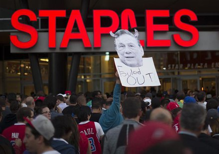 A photo cutout of Los Angeles Clippers owner Donald Sterling is seen among people standing in line for the NBA playoff game 5 between Golden