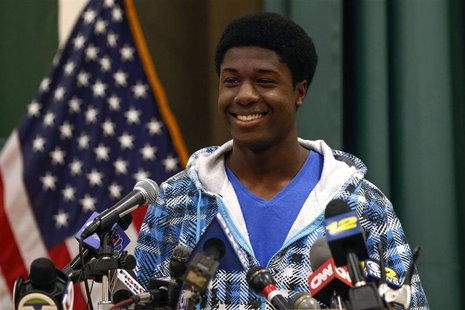 Kwasi Enin, a high school senior, smiles after announcing he will attend Yale University during a press conference at William Floyd High Sch